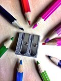 Pencils and sharpner. Close view of coloured pencils and sharpner Stock Photo