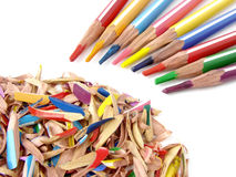 Pencils and shavings. Fragment of the set of color pencils with its shavings Royalty Free Stock Photos