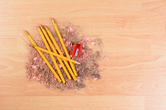 Pencils on Shavings. High angle view of yellow number 2 pencils on a school desk with a sharpener and shavings. Horizontal with copy space. Back to school Royalty Free Stock Photos