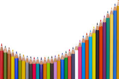 Pencils show abstract success with chart. Crayons show success with chart at stock market Royalty Free Stock Photos