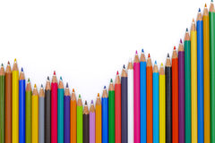 Pencils show abstract success with chart. Crayons show success with chart at stock market Royalty Free Stock Images
