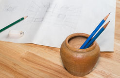 Pencils & sketch. Pencils and sketch on wooden table Royalty Free Stock Image