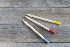 Pencils. Some colored pencils on a wooden background Stock Photos