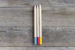 Pencils. Some colored pencils on a wooden background Royalty Free Stock Photo