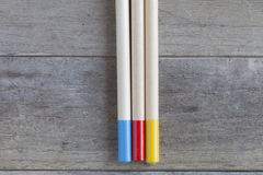 Pencils. Some colored pencils on a wooden background Stock Image
