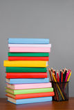 Pencils on the stack of books Stock Photo
