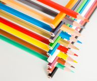 Pencils stacked in log house Stock Photography