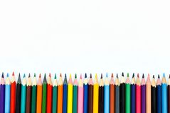 school children& x27;s colored pencils laid out in line on a white background royalty free stock photography