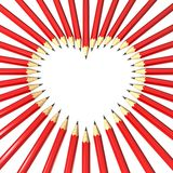 Pencils surrounding heart shaped space Royalty Free Stock Images