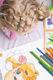 Pencils and tails of hair Royalty Free Stock Images