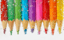 Pencils in water Royalty Free Stock Photos