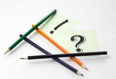 Pencils on white background with stickers and signs Royalty Free Stock Photo