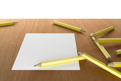 Pencils and white blank paper Royalty Free Stock Photos