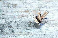 Pencils on a wooden Desktop Stock Photo