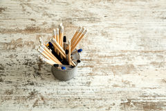 Pencils on a wooden Desktop. Some Pencils on a wooden Desktop Royalty Free Stock Images