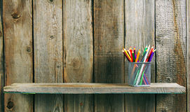 Pencils on a wooden shelf. Stock Photography