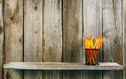 Pencils on a wooden shelf. Stock Image