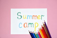 Pencils and words SUMMER CAMP. On color background, top view Stock Image