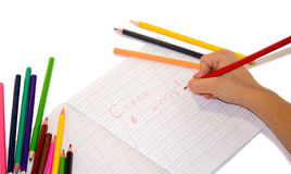 Pencils and Writing. On a white background isolated Royalty Free Stock Photos