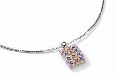 Pendant. Colorful diamond pendant on white background stock photos
