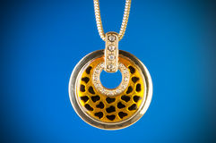 Pendant against colour background Royalty Free Stock Image