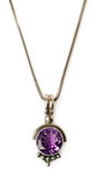 Pendant with amethyst and chain Royalty Free Stock Photography