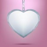 Pendant argenté dans la forme du coeur sur le réseau. ENV 8 Photo libre de droits