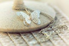 Pendant argenté de papillon Photos stock