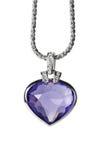 Pendant argenté et pierre gemme en forme de coeur bleue Photo stock