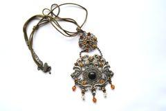 Pendant. Beautiful large pendant around his neck Royalty Free Stock Images