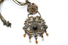 Pendant. Beautiful large pendant around his neck Royalty Free Stock Photography