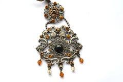 Pendant. Beautiful large pendant around his neck Royalty Free Stock Photo
