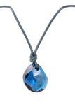 Pendant /stone. Pendant / blue stone, isolated on white royalty free stock photography