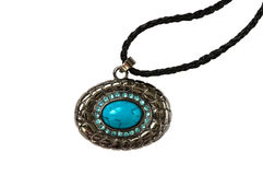Pendant with blue stone  on white. The turquoise stone. Royalty Free Stock Images