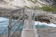 Pendant bridge over the Jostedola river. Royalty Free Stock Photography