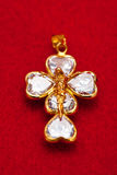 Pendant of a crucifix Stock Images