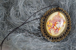 A pendant with a girl Royalty Free Stock Image