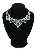 Pendant with green gem stones on black mannequin isolated on whi Stock Photos