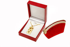 Pendant in jewelry box. With a red jewelry bag on white Stock Image