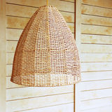 Pendant light with wicker lampshade Royalty Free Stock Image