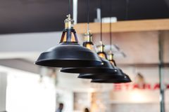 Pendant lighting for kitchen. Black pendant lighting for kitchen close up photo, Shallow DOF royalty free stock photography