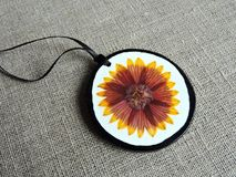 Handmade pendant from dried pressed  flower Stock Photos