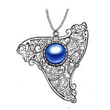 Pendant ornament in Celtic style. Ancient amulet with blue gem or pearl on the white background. Royalty Free Stock Photo