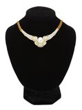 Pendant with pearl on black mannequin isolated on white Royalty Free Stock Photography