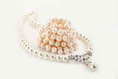 Pendant on pearl chain. Isolated on light background Royalty Free Stock Photography