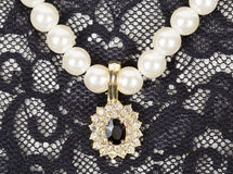 Pendant on pearls Stock Photos