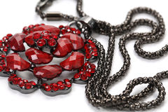 Pendant of red gem with chain. Closeup photo of pendant with chain white background Royalty Free Stock Photography
