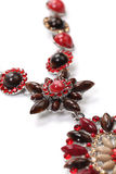 Pendant of red gems with necklace. Closeup photo of necklace with pendant over white Royalty Free Stock Photos