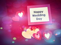 Pendant un jour du mariage heureux d'inscription de jour du mariage avec des coeurs photographie stock libre de droits