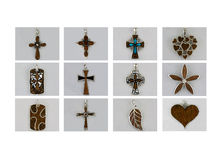 Pendants collection. The collection of silver pendants made from wood and gems stone Royalty Free Stock Photography